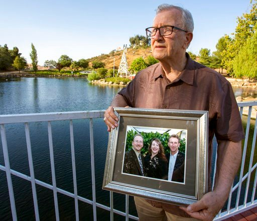 (Andrew Foulk/The Orange County Register via AP, File). In this Friday, June 23, 2017, file photo, Frank Kerrigan holds onto a photograph of his three children John, Carole, and Frank, near Wildomar, Calif.