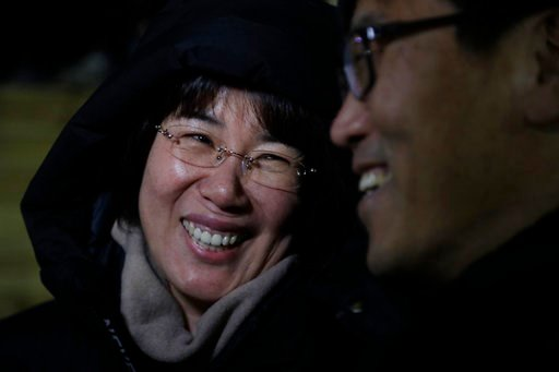 (AP Photo/Julio Cortez). In a photo taken Monday, Feb. 12, 2018, Heo Saeng-gum, left, and her husband Kim Woo Il, right, react during an interview before entering the Kwandong Hockey Center to watch their daughter Kim Selin play for the Koreas during a...
