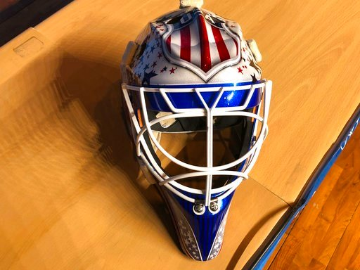 (AP Photo/Stephen Whyno). In this Monday, Feb. 12, 2018 photo, the mask of United States men's hockey goaltender Brandon Maxwell is displayed at the 2018 Winter Olympics, in Pyeongchang, South Korea. The mask is a mix of the U.S. logo and stars and str...