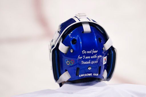(AP Photo/Jae C. Hong). A Bible verse is written on the back of the joint Korean women's ice hockey team goalie Han Dohee's mask during a training session prior to the 2018 Winter Olympics in Gangneung, South Korea, Monday, Feb. 5, 2018.