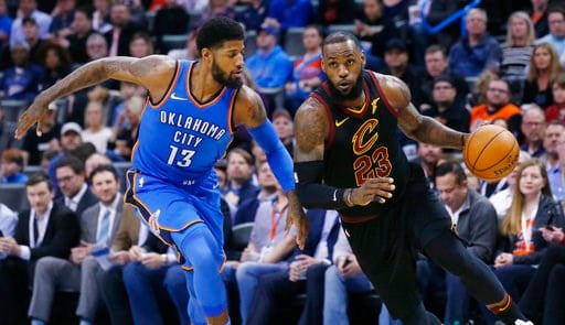 (AP Photo/Sue Ogrocki). Cleveland Cavaliers forward LeBron James (23) drives past Oklahoma City Thunder forward Paul George (13) during the first half of an NBA basketball game in Oklahoma City, Tuesday, Feb. 13, 2018.