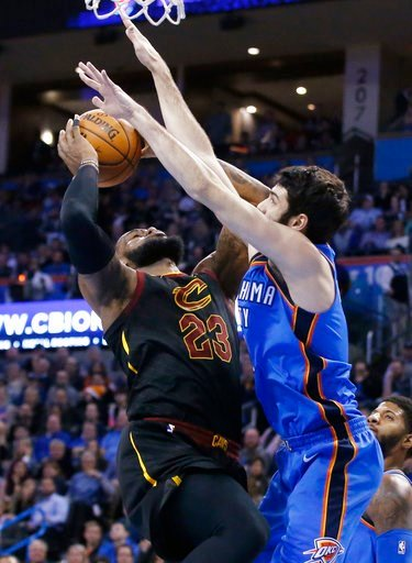(AP Photo/Sue Ogrocki). Cleveland Cavaliers forward LeBron James, left, is fouled by Oklahoma City Thunder guard Alex Abrines as he shoots during the first half of an NBA basketball game in Oklahoma City, Tuesday, Feb. 13, 2018.