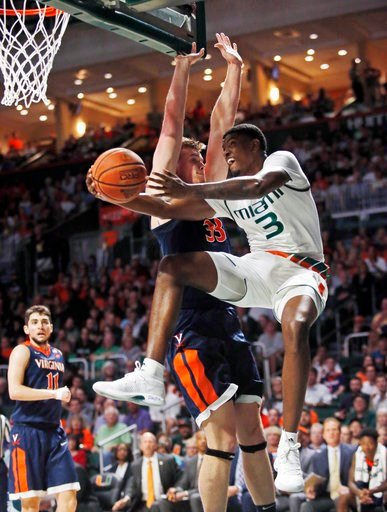 (AP Photo/Wilfredo Lee). Miami guard Anthony Lawrence II (3) goes up for a shot against Virginia center Jack Salt (33) during the first half of an NCAA college basketball game, Tuesday, Feb. 13, 2018, in Coral Gables, Fla.