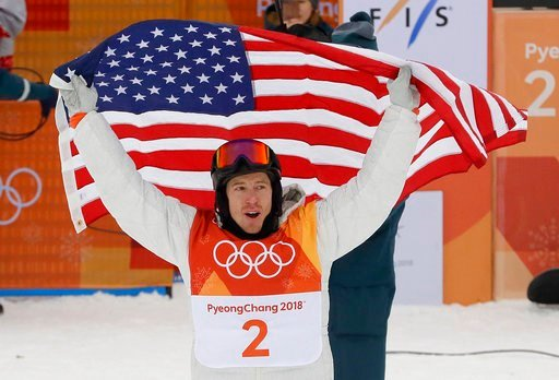 (AP Photo/Kin Cheung). Shaun White, of the United States, celebrates his gold medal after the men's halfpipe finals at Phoenix Snow Park at the 2018 Winter Olympics in Pyeongchang, South Korea, Wednesday, Feb. 14, 2018.