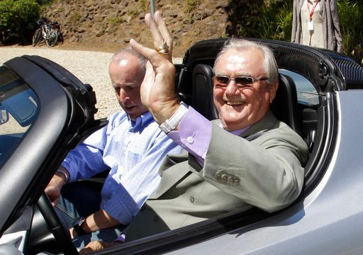 (AP Photo/Paul Sakuma, File). FILE - In this June 13, 2011, file photo, Denmark's Prince Henrik, right, waves as he drives a Tesla Roadster at the electric car maker's headquarters in Palo Alto, Calif. Denmark's royal palace says the 83-year-old Prince...
