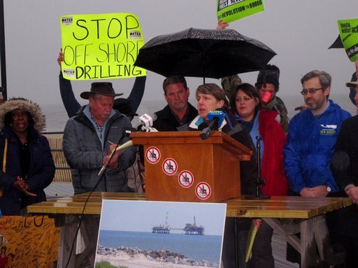 (AP Photo/Wayne Parry, File). FILE - In this Wednesday, Feb. 7, 2018 file photo, Cindy Zipf, executive director of the Clean Ocean Action environmental group, speaks at a rally in Asbury Park, N.J., against President Trump's plan to allow oil and natur...
