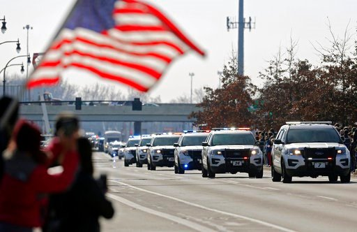 (Adam Cairns/The Columbus Dispatch via AP). The Police escort of Westerville Police officers Morelli and Joering home from Franklin County Coroners office today as they head north of S. State Street in Westerville, Ohio, Monday, Feb. 12, 2018.