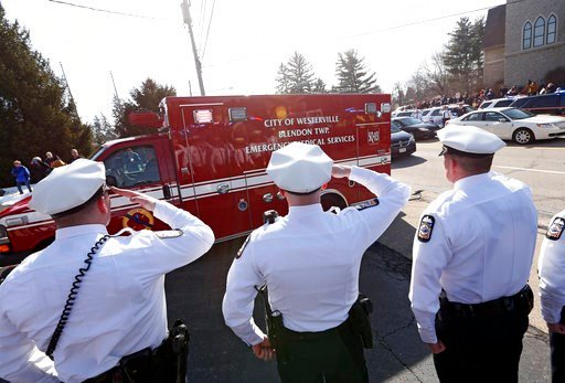 (Adam Cairns/The Columbus Dispatch via AP). Columbus Police honor guard members salute the ambulance carrying the body of Westerville Police officer Eric Joering during a procession transporting the bodies of Joering and Anthony Morelli from the Frankl...