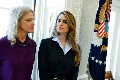 (AP Photo/Evan Vucci). White House Communications Director Hope Hicks, right, stands with White House senior adviser Kellyanne Conway during a meeting in the Oval Office between President Donald Trump and Shane Bouvet, Friday, Feb. 9, 2018, in Washington.