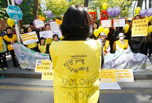 (AP Photo/Ahn Young-joon, File). FILE - In this Oct. 19, 2011 file photo, former South Korean comfort women who were forced to serve for the Japanese Army as sexual slaves during World War II, stage a rally to demand an official apology and compensatio...