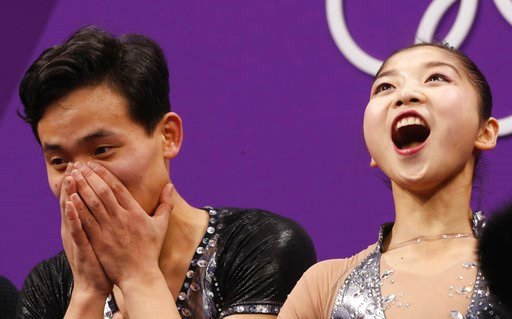 (AP Photo/Bernat Armangue). Ryom Tae Ok and Kim Ju Sik of North Korea react after their scores are posted following their performance in the pair figure skating short program in the Gangneung Ice Arena at the 2018 Winter Olympics in Gangneung, South Ko...
