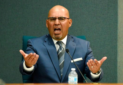 (AP Photo/Chris Pizzello). Pico Rivera, Calif., City Councilman and El Rancho High School teacher Gregory Salcido addresses the public during a city council meeting at Pico Rivera City Hall on Tuesday, Feb. 13, 2018, in Pico Rivera, Calif. The city cou...