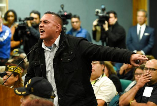 (AP Photo/Chris Pizzello). Andre Eric Martinez of Pico Rivera, Calif. addresses Pico Rivera City Councilman and El Rancho High School teacher Gregory Salcido during a city council meeting on Tuesday, Feb. 13, 2018, in Pico Rivera, Calif. The city counc...