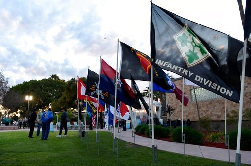 (AP Photo/Chris Pizzello). A row of military flags are pictured in front of Pico Rivera City Hall before a a city council meeting on Tuesday, Feb. 13, 2018, in Pico Rivera, Calif. The city council is to consider a resolution asking for the resignation ...