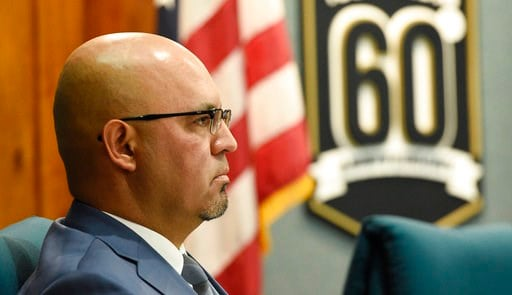 (AP Photo/Chris Pizzello). Pico Rivera City Councilman and El Rancho High School teacher Gregory Salcido listens to public remarks during a city council meeting at Pico Rivera City Hall on Tuesday, Feb. 13, 2018, in Pico Rivera, Calif. The city council...