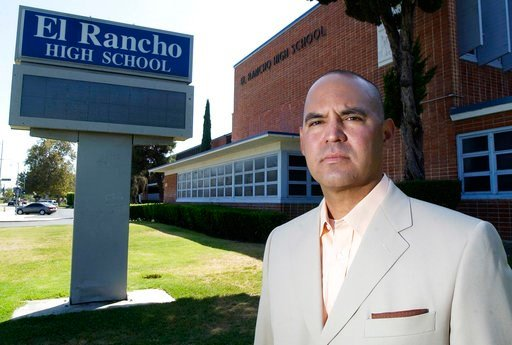 (Keith Durflinger/Los Angeles Daily News via AP). FILE - In this July 21, 2010, file photo, teacher Gregory Salcido poses in front of El Rancho High School in Pico Rivera, Calif. A Los Angeles-area city council will consider a resolution Tuesday, Feb. ...