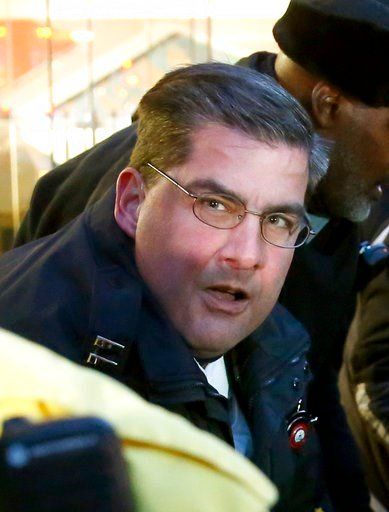 (AP Photo/Charles Rex Arbogast). In this Feb. 23, 2016, photo, then Chicago police Capt. Paul Bauer takes part in the arrest of a protester outside an Apple store on Magnificent Mile in Chicago.