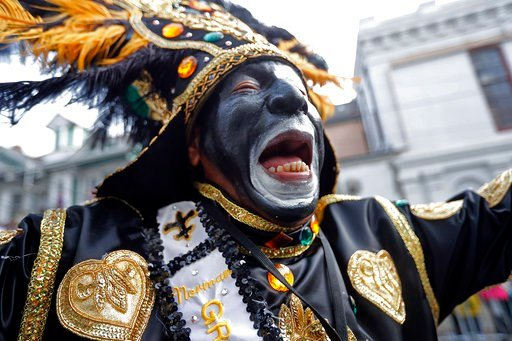 (AP Photo/Gerald Herbert). A member of the Krewe of Zulu marches during their parade Mardi Gras day in New Orleans, Tuesday, Feb. 13, 2018.