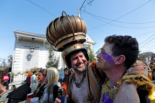 (AP Photo/Gerald Herbert). A man uses an attic vent as headgear during the Society de Sainte Anne parade, on Mardi Gras day in New Orleans, Tuesday, Feb. 13, 2018.