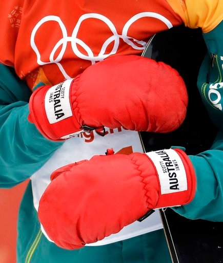 (AP Photo/Lee Jin-man). ScottyJames, of Australia, gribs his board with is gloves during the men's halfpipe finals at Phoenix Snow Park at the 2018 Winter Olympics in Pyeongchang, South Korea, Wednesday, Feb. 14, 2018.