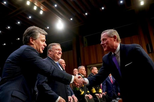(AP Photo/Andrew Harnik). Chairman Richard Burr, R-N.C., right, greets FBI Director Christopher Wray, left, before a Senate Select Committee on Intelligence hearing on worldwide threats, Tuesday, Feb. 13, 2018, in Washington.