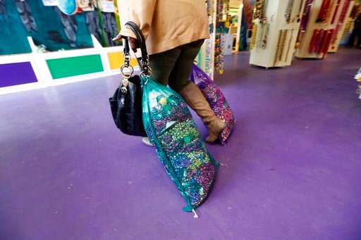 (AP Photo/Gerald Herbert). Iraneka Sanders, of Reserve, La., drags bags of recycled Mardi Gras beads to the cashier, at the Arc of Greater New Orleans, in New Orleans, Thursday, Feb. 8, 2018. Mardi Gras produces fun-filled days of merriment, joy and th...