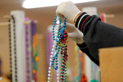 (AP Photo/Gerald Herbert). Workers sort Mardi Gras beads to recycle, at the Arc of Greater New Orleans, in New Orleans, Thursday, Feb. 8, 2018. Mardi Gras produces fun-filled days of merriment, joy and the occasional hangover. It also produces a lot of...
