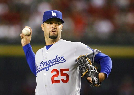 (AP Photo/Ross D. Franklin, File). FILE - In this Sept. 21, 2007 file photo, Los Angeles Dodgers' Esteban Loaiza, of Mexico, throws a pitch against the Arizona Diamondbacks in the first inning of a baseball game in Phoenix. Former All-Star pitcher Loai...