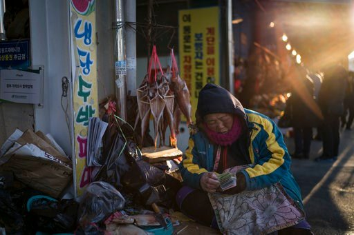 (AP Photo/Felipe Dana). A woman selling fish waits for customers at a market in Gangneung, South Korea, Monday, Feb. 12, 2018. One part of the Pyeongchang area that hasn't been Westernized and beautified for the Winter Olympics is the traditional marke...