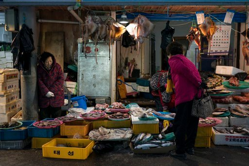 (AP Photo/Felipe Dana). A woman shops for fish at the traditional market in Gangneung, South Korea, Tuesday, Feb. 13, 2018. While the Winter Olympics are going on in the mountains, some serious haggling is underway on the coast. One part of the Pyeongc...