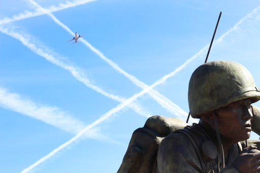 (AP Photo/Bob Christie). In this Friday, Feb. 9, 2018 photo, a low-flying jetliner that just took off from Phoenix Sky Harbor International Airport banks over the Navajo Code Talkers memorial at the Arizona Capitol. Last year's court victory by Phoenix...