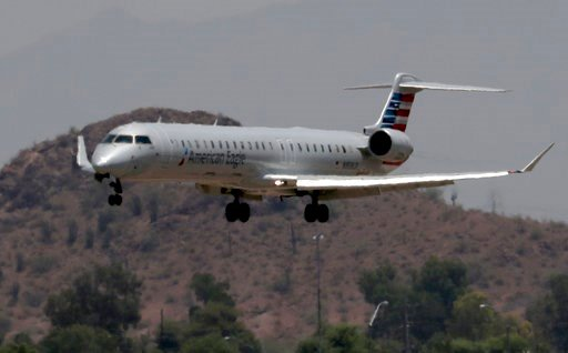 (AP Photo/Matt York, File). FILE - In this June 19, 2017, file photo, an American Eagle jet flies through heat ripples as it lands at Sky Harbor International Airport in Phoenix. Last year's court victory by Phoenix and neighborhood groups over the Fed...