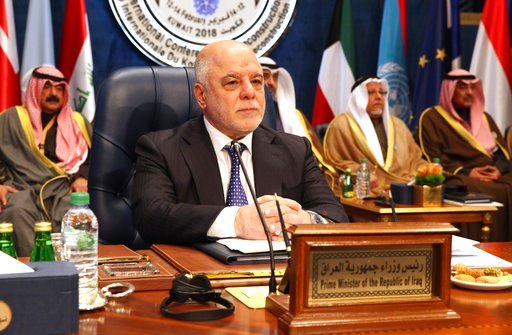 (AP Photo/Jon Gambrell). Iraqi Prime Minister Haider al-Abadi prepares for a donor's summit at Bayan Palace in Kuwait City, Kuwait, Wednesday, Feb. 14, 2018. Kuwait on Wednesday hosted the final day of a conference seeking billions of dollars to help r...