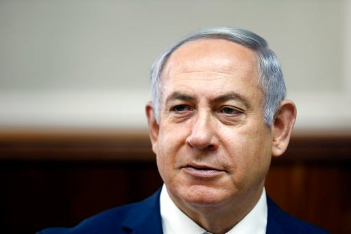 (Ronen Zvulun, Pool via AP, File). FILE - In this Sunday, Feb. 11, 2018 file photo, Israeli Prime Minister Benjamin Netanyahu chairs the weekly cabinet meeting at the Prime Minister's office in Jerusalem. Israeli media reports Tuesday, Feb. 13, 2018 sa...