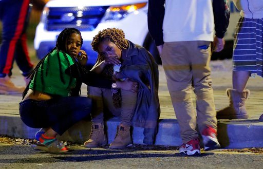 (AP Photo/Gerald Herbert). A woman is comforted as police investigate the scene of a Mardi Gras day shooting that left at least one dead and others injured, in the lower ninth ward in New Orleans, Tuesday, Feb. 13, 2018.