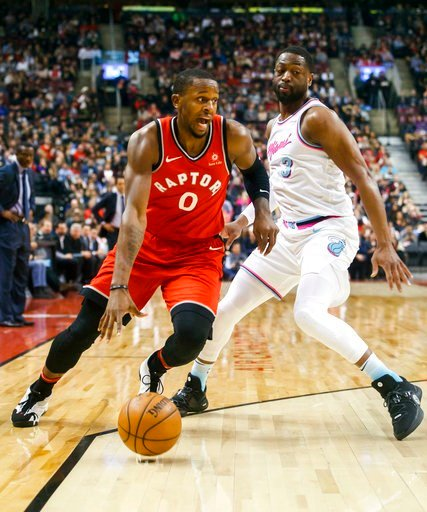 (Mark Blinch/The Canadian Press via AP). Toronto Raptors' CJ Miles goes to the basket against Miami Heat guard Dwyane Wade during the first half of an NBA basketball game, Tuesday, Feb. 13, 2018, in Toronto.