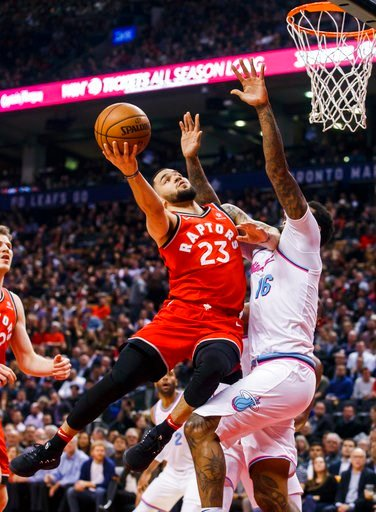 (Mark Blinch/The Canadian Press via AP). Toronto Raptors' guard Fred VanVleet goes to the basket against Miami Heat forward James Johnson, right, during the first half of an NBA basketball game, Tuesday, Feb. 13, 2018, in Toronto.