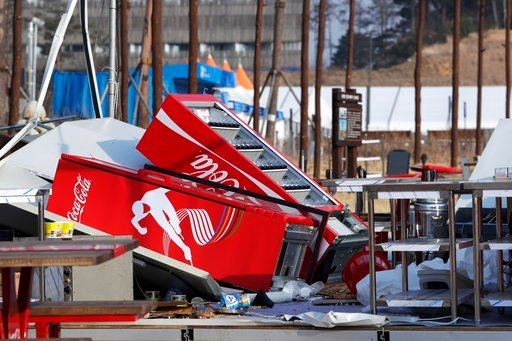 (AP Photo/Julio Cortez). Refrigerators are toppled after they were blown over at a concession stand by gusty winds at the Olympic Park at the 2018 Winter Olympics in Gangneung, South Korea, Wednesday, Feb. 14, 2018. Gusts forced organizers to shut down...