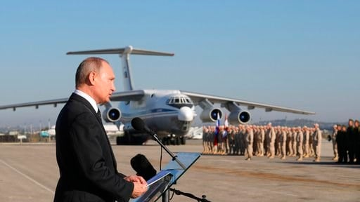 (Mikhail Klimentyev/Pool Photo via AP, File). FILE - In this file photo taken on Tuesday, Dec. 12, 2017, Russian President Vladimir Putin addresses the troops at the Hemeimeem air base in Syria. Several private Russian military contractors were killed ...