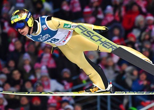 (AP Photo/Alik Keplicz, File). FILE - In this Jan. 28, 2018 file photo, Japan's Noriaki Kasai soars through the air during the 18th World Cup Ski Jumping competition, in Zakopane, Poland. Kasai is showing no sign of slowing down. One of six male ski ju...
