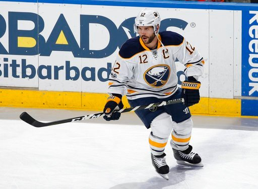 (AP Photo/Joel Auerbach, File). FILE - In this April 8, 2017, file photo, Buffalo Sabres right wing Brian Gionta (12) skates prior to an NHL hockey game against the Florida Panthers, in Sunrise, Fla. As the longtime NHL veterans try to win a medal for ...