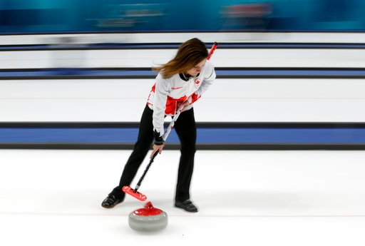 (AP Photo/Aaron Favila). Canadian curler Cheryl Bernard sweeps ice during a training session for the women's curling matches at the 2018 Winter Olympics in Gangneung, South Korea, Monday, Feb. 12, 2018. Bernard, 51, is the oldest athlete competing at t...