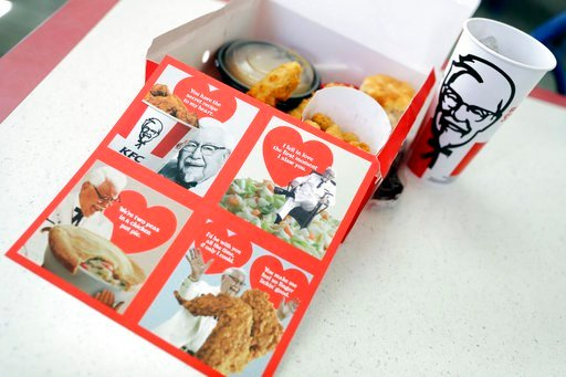 (AP Photo/Marcio Jose Sanchez). Valentine's Day scratch-and-sniff cards, which give off a fried chicken aroma, sit on a table at a KFC, Tuesday, Feb. 13, 2018, in Santa Clara, Calif. KFC is handing out the cards to diners who buy its $10 Chicken Share ...