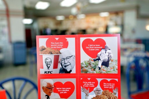 (AP Photo/Marcio Jose Sanchez). Valentine's Day scratch-and-sniff cards, which give off a fried chicken aroma, are seen at a KFC, Tuesday, Feb. 13, 2018, in Santa Clara, Calif. In an attempt to capture a bit of the $3.7 billion that the National Retail...
