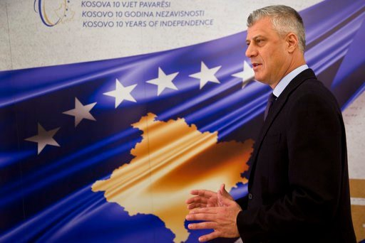 (AP Photo/Visar Kryeziu). Kosovo President Hashim Thaci stands in front of a banner marking the 10th anniversary of Kosovo independence during an interview with The Associated Press on Wednesday Feb. 14, 2018, in Kosovo capital Pristina.  Thaci said 20...