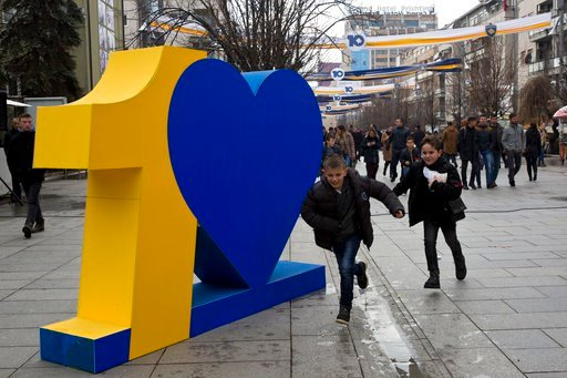 (AP Photo/Visar Kryeziu). Kosovar kids run in front of a number ten sign marking the 10th anniversary of Kosovo independence on Wednesday Feb. 14, 2018, in Kosovo capital Pristina. Kosovo president Hashim Thaci said 2018 would be the year of a historic...