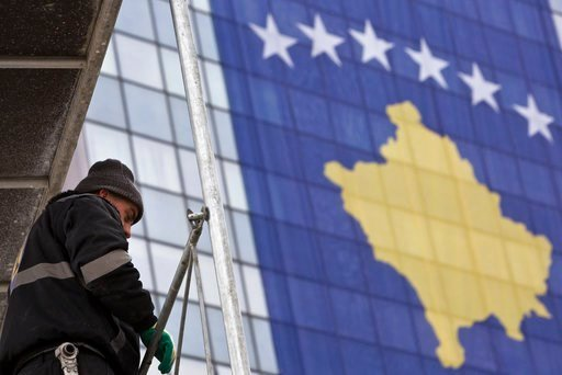 (AP Photo/Visar Kryeziu). A construction worker prepares the area  for the 10th anniversary of Kosovo independence on Wednesday Feb. 14, 2018, in Kosovo capital Pristina. Kosovo President Hashim Thaci said 2018 would be the year of a historic deal on n...