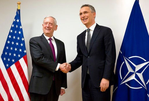 (AP Photo/Virginia Mayo, Pool). NATO Secretary General Jens Stoltenberg, right, shakes hands with U.S. Secretary for Defense Jim Mattis prior to a meeting at NATO headquarters in Brussels on Wednesday, Feb. 14, 2018. NATO defense ministers begin a two-...