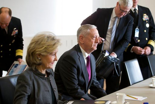 (AP Photo/Virginia Mayo, Pool). U.S. Secretary for Defense Jim Mattis, center, waits for the start of a meeting at NATO headquarters in Brussels on Wednesday, Feb. 14, 2018. NATO defense ministers begin a two-day meeting Wednesday to focus on military ...