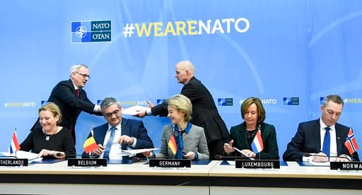 (Frederic Sierakowski, Pool Photo via AP). From left, Dutch Defense Ank Bijleveld, Belgian Defense Minister Steven Vandeput, German Defense Minister Ursuala von der Leyen, Luxembourg's Permanent NATO Representative Arlette Conzemius and Norway's Defens...